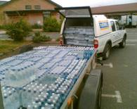 Unloading water at the Wheatpieces Community Centre, Walton Cardiff, near Tewkesbury, following the July 2007 Floods