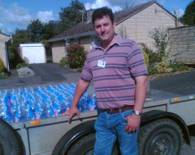 In July-August 2007, Adam spent over 2 weeks coordinating and delivering bottled water across the Ashchurch with Walton Cardiff Ward. Pictured here in Pamington delivering to the service point set up by then County Councillor Gordon Shurmer